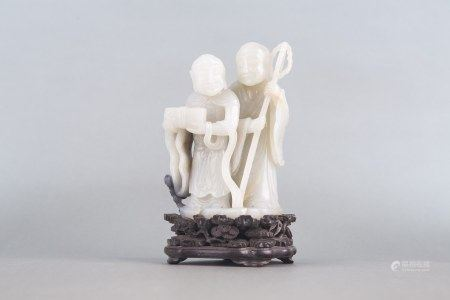 A WHITE JADE CARVING OF THE 'HEHE ERXIAN' QING PERIOD