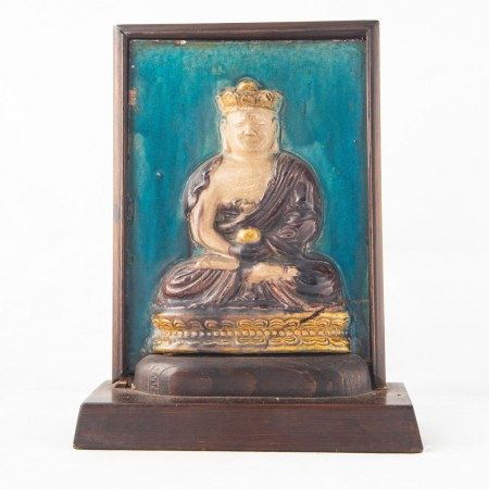 A CHINESE FAMILLE VERTE GAUTAMA PLAQUE, MING PERIOD