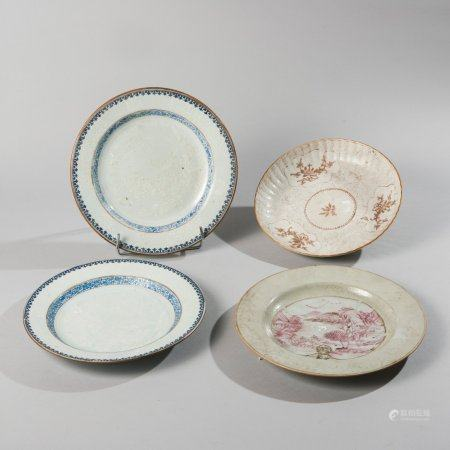 Set of four blue, white and polychrome enamelled...