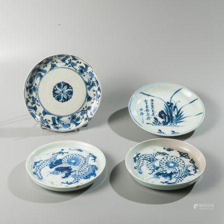 Set of four porcelain plates enamelled in...