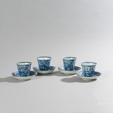 Set of four cups and four saucers in white...