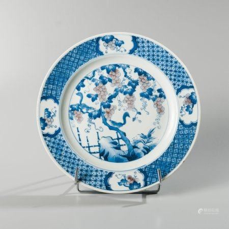 White blue enamelled porcelain plate decorated...