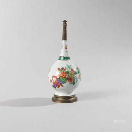 Small bottle vase with long narrow neck in...