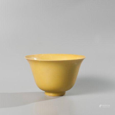 Flared rim bowl in yellow enamelled porcelain,...