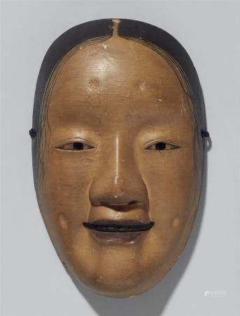A painted wood nô mask. 19th century