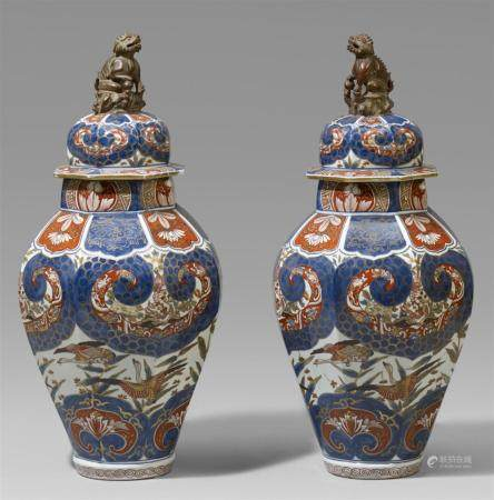 A pair of Samson lidded baluster vases. 19th century