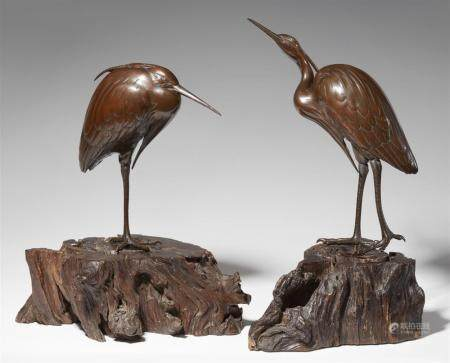 A pair of bronze models of herons. Around 1900