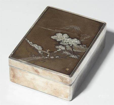 A silver and black-lacquered wood cigarette box. Around 1900