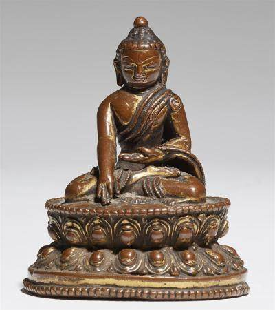 A small Nepalese bronze figure of Buddha Shakyamuni. 14th ce
