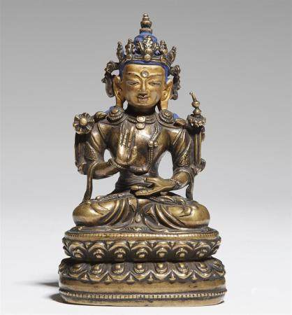 A Tibetan bronze figure of Maitreya. 16th century