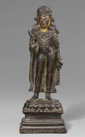 A rare Kashmiri or Western Tibetan silver-inlaid dark bronze