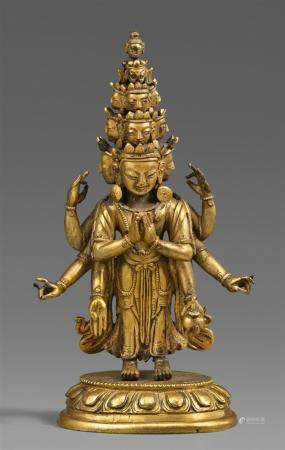 A Tibeto-Chinese gilt bronze figure of the eleven-headed Ava