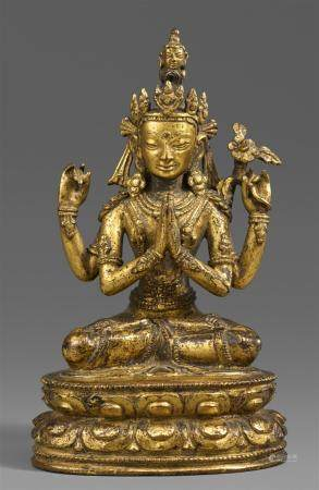 A Tibetan gilt bronze figure of Shadakshari Avalokiteshvara.