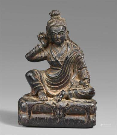 A Tibetan wooden figure of Milarepa. 18th/19th century