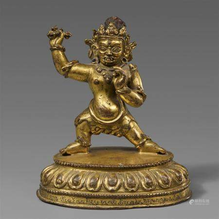 A Tibetan gilt bronze figure of Vajrapani. 15th century