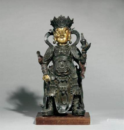A partly gilt bronze figure of a guardian (vajrapani). 17th/