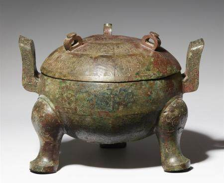 A large bronze tripod ritual food vessel (ding) and cover. N