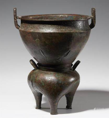 A two-part bronze food vesssel (xian or yan). Western Zhou d