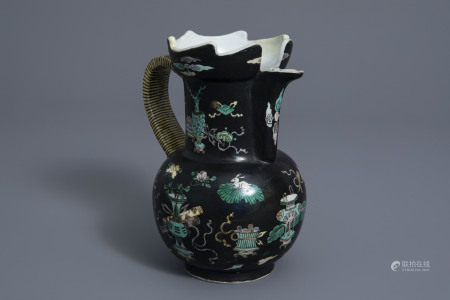 A Chinese famille noire jug with antiquities design, Kangxi mark, 19th C.