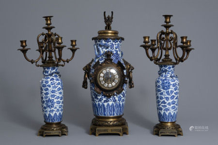 A Chinese three-piece bronze mounted blue and white porcelain garniture, 19th C.