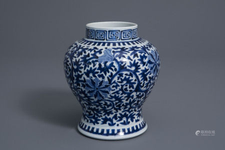 A Chinese blue and white baluster vase with floral design, Kangxi mark, 19th C.