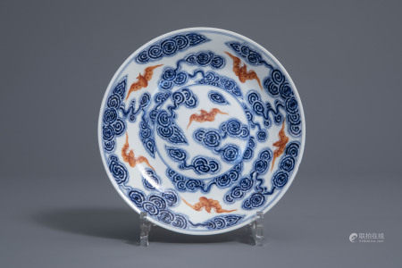 A Chinese blue, white and iron red 'bats and clouds' plate, 19th/20th C.