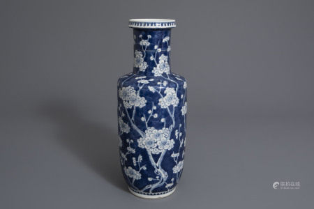A Chinese blue and white rouleau vase with prunus on cracked ice, 19th C.