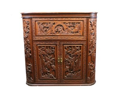 A CHINESE CARVED  CAMPHOR WOOD CABINET 20TH C.