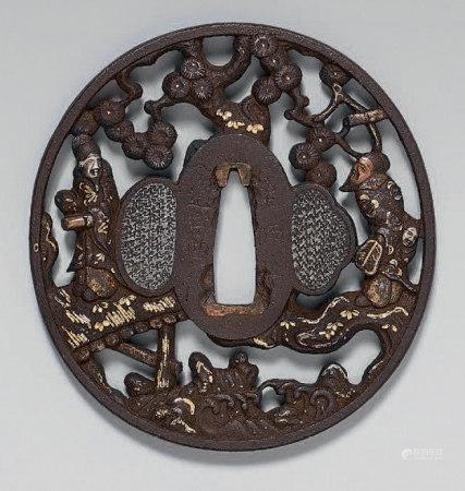 Tsuba en fer ajouré rehaussé or, argent et cuivre, représent