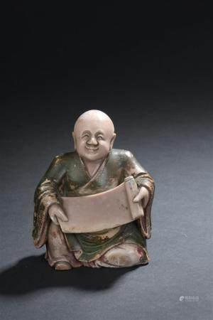 Statuette de Luohan en stéatite laquéeChine, XIXe siècleRepré