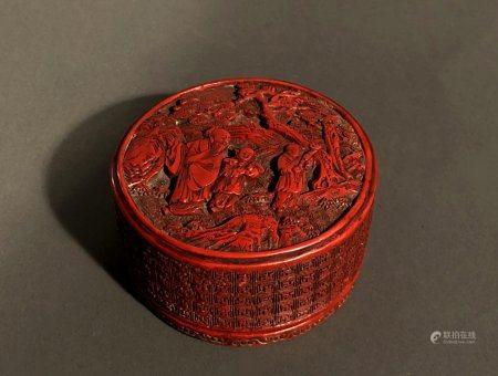CHINE. BOÎTE circulaire en laque de cinabre sculpté d'un lett