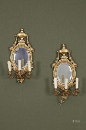 Paire d'appliques médaillon à fond miroir à 3 bras de lumière  Encadrement en [...]