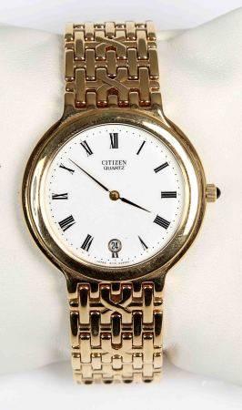 Reloj de pulsera, de la marca CITIZEN.  Chapado en oro, con esfera blanca circular, [...]