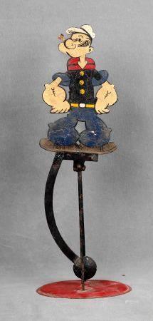 Tentetieso representando a Popeye, el Marino. En chapa policromada. Med.: [...]