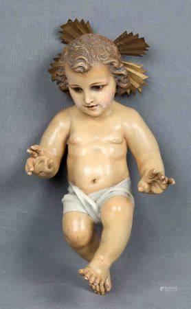 Niño Jesús. En escayola policromada, con ojos en pasta vítrea y corona en latón. [...]