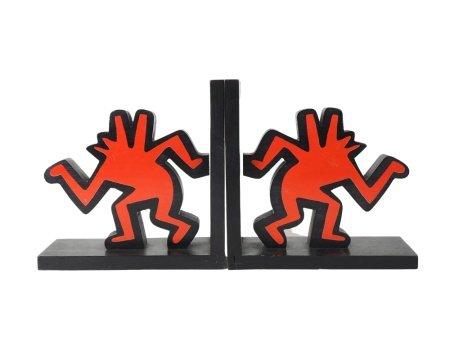 Keith Haring (1958-1990), d'après  - Paire de serres livres, cachet Authorized by [...]