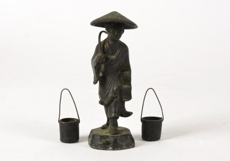 A Chinese bronze figure, taking the form of a figure with a conical hat and implement, together with