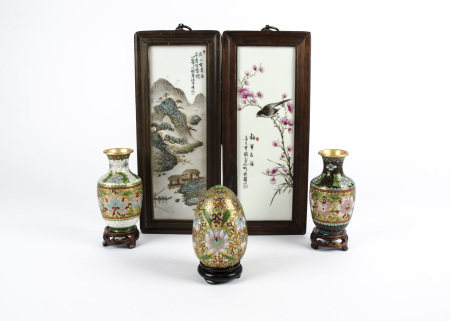 A pair of Chinese Republic Period famille rose plaques, one depicting a bird perched on a branch,