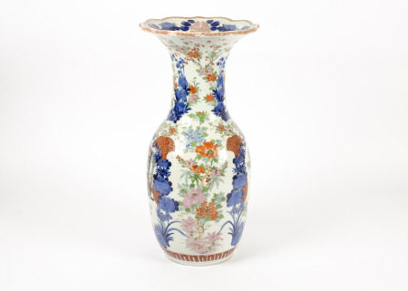 A large early 20th Century Japanese vase, baluster shape with a fluted rim, decorated with