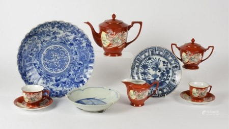 A Chinese 20th Century tea set, upon a red ground with cartouches of a female deity amidst clouds,