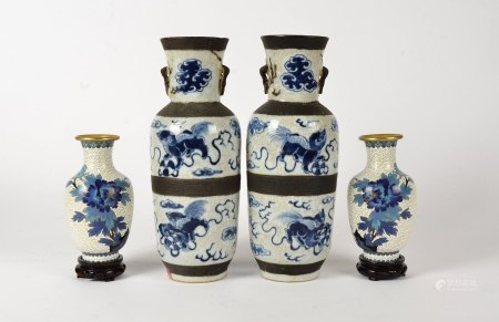 A pair of Chinese crackleware vases, with three glazed sections, divided by bisque borders, each