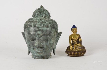 A cast metal Buddhist head, height 19cm, together with a seated Buddhist figure in the lotus