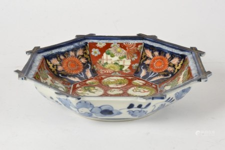 A Japanese arita ware octagonal plate, with typical imari palette and interesting central