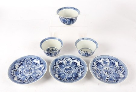 Three blue and white tea bowls and saucers, in the Kraak tradition but later, divided into