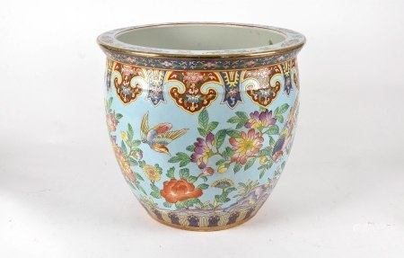 A large 20th Century Chinese Famille Rose porcelain fish bowl, the sides of the bowl decorated
