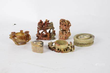 A small collection of Chinese agate and soapstone sculptures, including a small vessel surrounded by