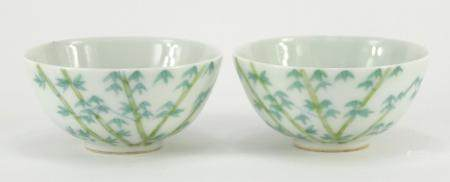 Pair of Chinese porcelain bowls hand painted with bamboo, character marks to the bases, each 9cm