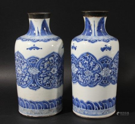 PAIR OF CHINESE BLUE AND WHITE VASES, perhaps 18th century or earlier, the cylindrical body