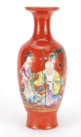 Chinese porcelain iron red ground vase, hand painted in the famille rose palette with Shou Lau