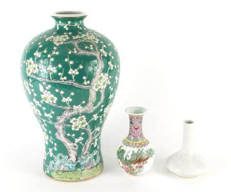 Three Chinese porcelain vases, the largest hand painted with a blossoming tree, 30cm high : For